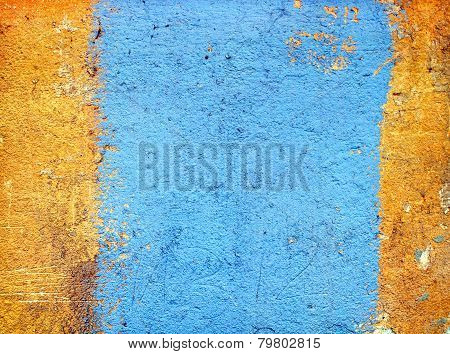 Texture Of Yellow Plaster With A Blue Stripe.