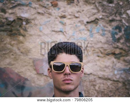 Fashionable Man Portrait Over Ruinous Wall Background