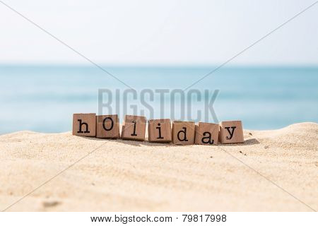 Holiday Season Word With Sunny Beach And Ocean Background
