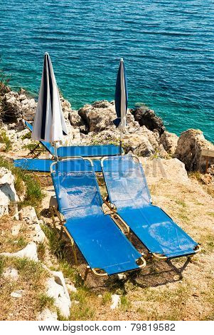 Sunbeds And Umbrellas (parasols) On The Beach In Corfu Island