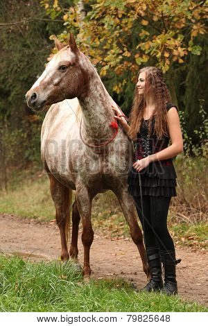 Amazing Girl Standing Next To The Appaloosa Horse