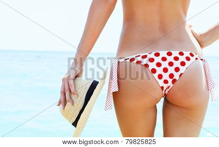 Beautiful young woman in sexy bikini at the beach poster