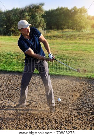 Golfer Plays A Sand Trap Shot