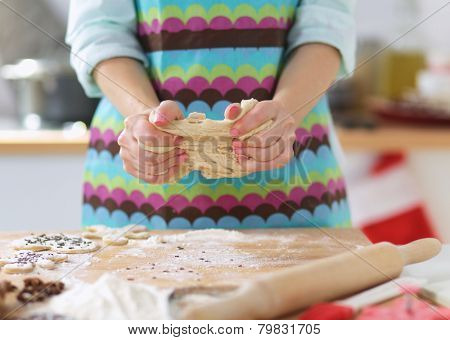 Woman kneading dough, close-up, in the kithen