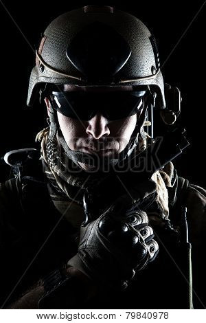 United States Army ranger with pistol on dark background poster
