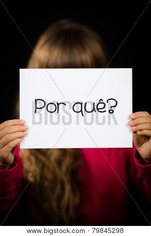 Child Holding Sign With Portuguese Word Por Que - Why