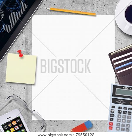 Blank paper with office and business work elements around