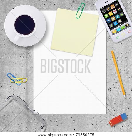 Blank paper with office work elements around