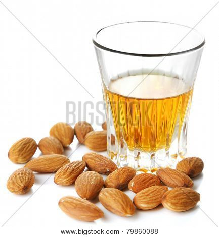 Dessert liqueur Amaretto with almond nuts, isolated on white poster