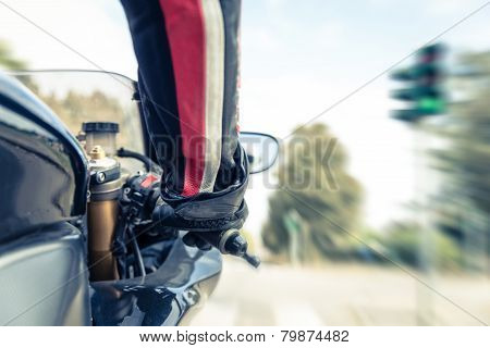 man accelerating at the green light with motorcycle poster