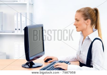 Woman works at the computer.