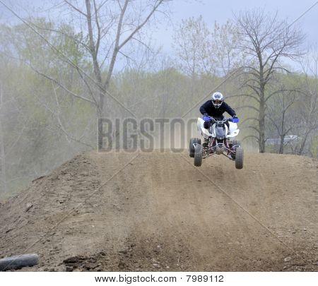 Racer Rides An Atv Down A Dirt Hill