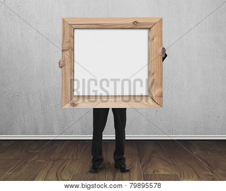 Man Holding Blank Whiteboard With Wooden Frame Indoors