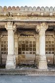 Carved stone grilles on the walls of the Tomb of Sufi Saint Shaikh Ahmed Khattu at Sarkhej Roza in Ahmedabad India poster