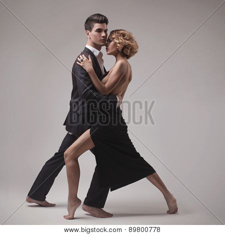 Well-dressed retro couple dancing tango