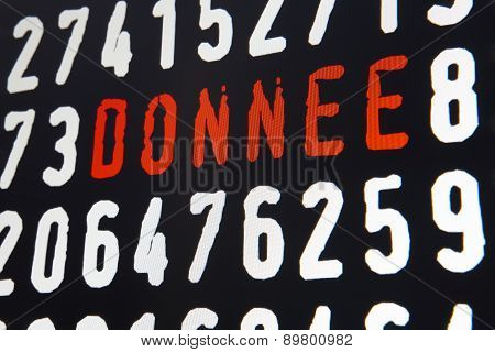 Computer Screen With Donnee Text And Numbers On Black Background
