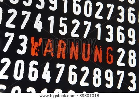 Computer Screen With Warnung Text And Numbers On Black Background