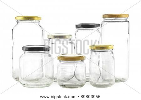 Group of seven different empty glass jars for preserves