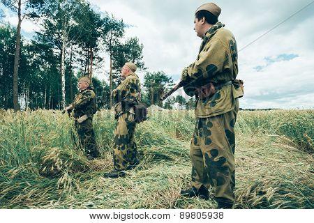 Unidentified re-enactors dressed as Soviet Russian soldiers duri
