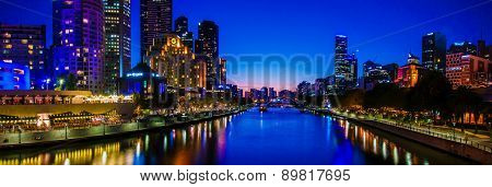 Panoramic Night View Over Yarra River And City Skyscrapers In Melbourne, Australia