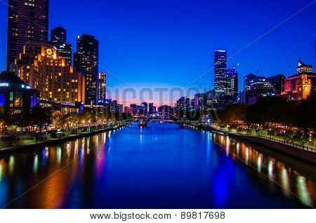 Night View Over Yarra River And City Skyscrapers In Melbourne, Australia