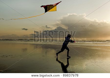 Boy With Kite At Sunset.