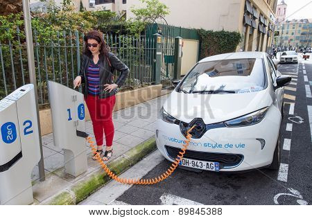 Woman Programming A Zen Charging Station To Charge A Renault Zoe Electric Car