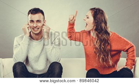 Angry Fury Woman Screaming Man Closes His Ears.