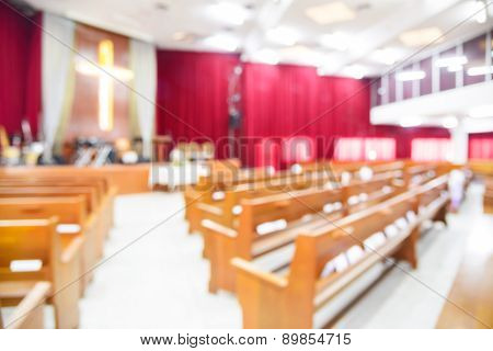 Blurred Interior Of Empty Church With Empty Pews