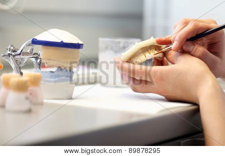 hands working in a dental laboratory, close up