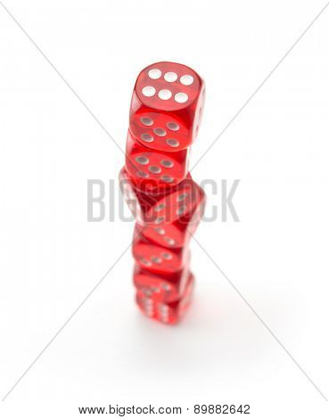 Red dice stacked up, isolated on white. Focus on top surface.