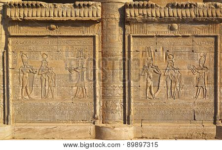 Hieroglyphic carvings on the exterior walls of an ancient egyptian temple  poster