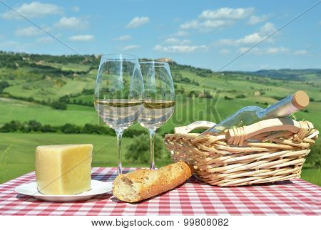White wine on the table against Tuscan landsacpe, Italy poster