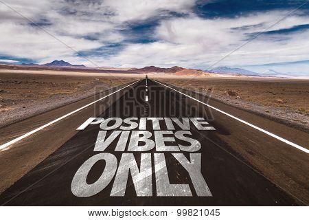 Positive Vibes Only written on desert road poster