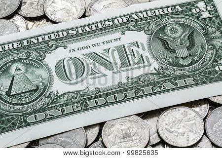 One Usa Dollar Bill On A Pile Of Quarters