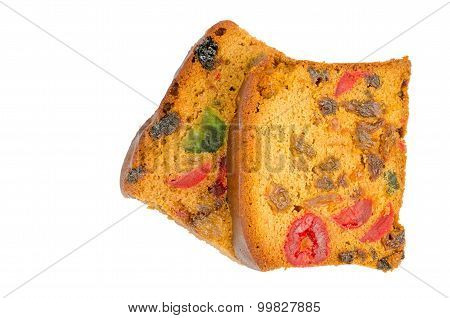 delicious sliced fruit cake with mixed fruit and cherries isolated on white background