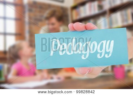 The word pedagogy and hand showing card against teacher helping pupils in library