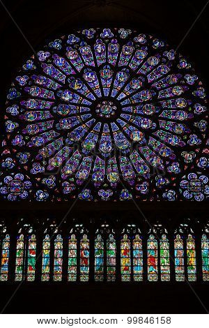 PARIS, FRANCE - SEPTEMBER 8, 2014:Paris Notre Dame Cathedral. North transept rose window. The Glorification of the Virgin Mary
