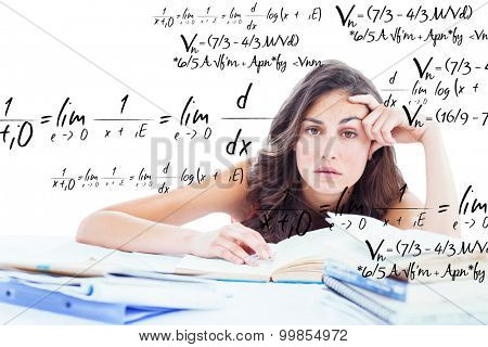 Bored student doing her homework against maths equation