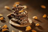 Dark brown chocolate and almonds with badam poster