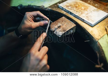 Jeweler polishing jewelry with tools workshop craft poster