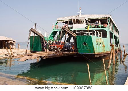 KOH SAMET, THAILAND - MAY 3, 2012: ferry with loading platform and cars in Thailand on the way to Koh Samet.