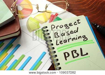 Notebook with project based learning PBL sign on a table.
