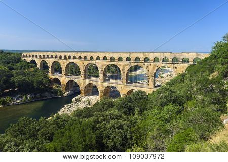 Pont du Gard is an old Roman aqueduct, southern France near Avignon poster