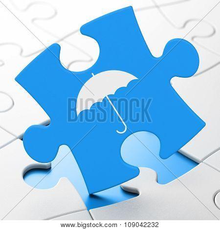Security concept: Umbrella on puzzle background