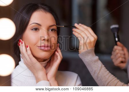 Experienced young beautician is working at beauty salon
