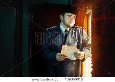 Sad Retro Man Standing Near The Window.