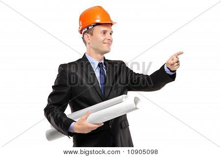 A View Of An Architect With Blueprints Pointing