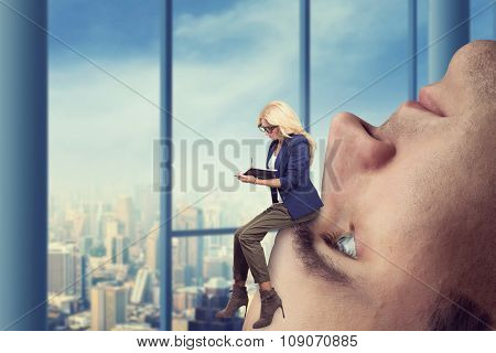 Businesswoman analyst sits on the male face