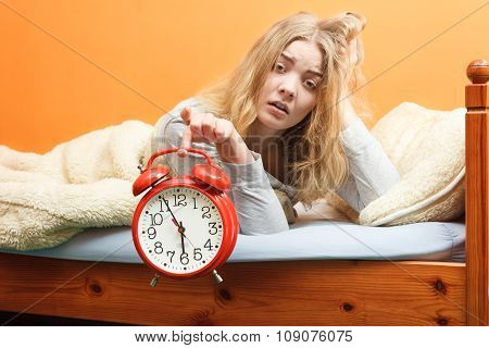 Unhappy Woman Waking Up With Alarm Clock.